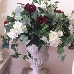 Sandstone urn with ivy and roses