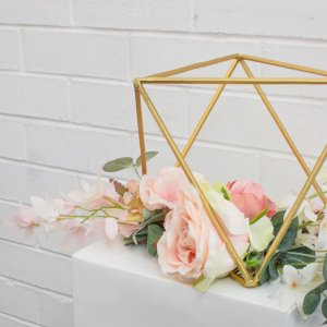 gold centrepiece with flowers