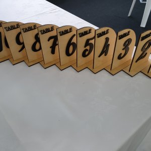 plywood table numbers with black letterings